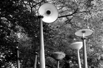 Oude lantaarnpalen op het terrein van een gesloten transformatorstation van NUON aan de Oude Beekbergerweg